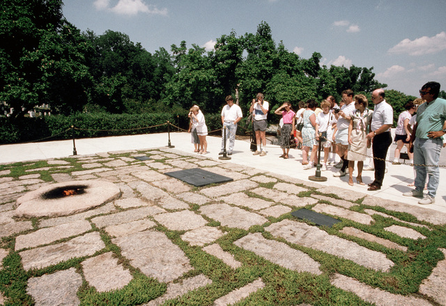 PH1 Chuck Mussi Arlington, Va....Tourists visit the gravesite of President John F. Kennedy at Arlington National Cemetery. OFFICIAL U.S. NAVY PHOTO (RELEASED)