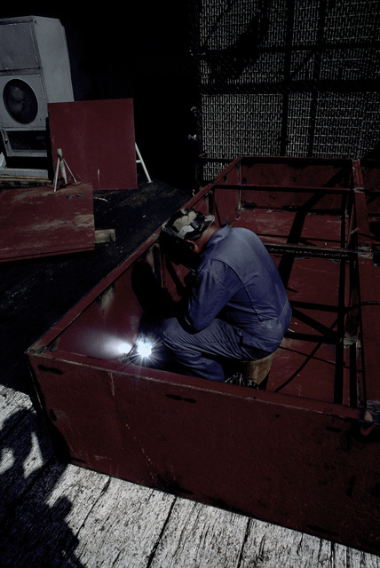 PH1 DeWayne Smith Persian Gulf....A barge worker welds a piece of metal aboard the barge Wimbrown 7. OFFICIAL U.S. NAVY PHOTO (RELEASED)