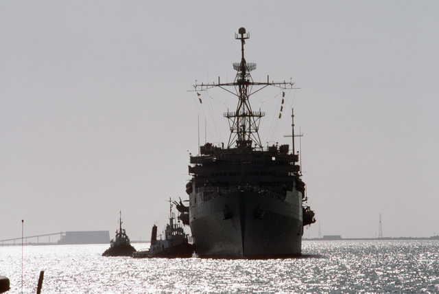 PH1 DeWayne Smith Persian Gulf....A bow view of the amphibious transport dock USS Dubuque (LPD-8) being assisted by large harbor tugs. OFFICIAL U.S. NAVY PHOTO (RELEASED)