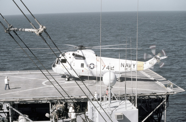 PH1 DeWayne Smith Persian Gulf....A Helicopter Combat Support Squadron 2 (HC-2) SH-3G Sea King helicopter assigned to the miscellaneous flagship USS La Salle (AGF-3) lands on the helicopter pad of the barge Wimbrown 7. OFFICIAL U.S. NAVY PHOTO (RELEASED)