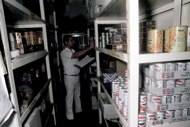 PH1 DeWayne Smith Persian Gulf....A storekeeper takes inventory aboard the barge Wimbrown 7. OFFICIAL U.S. NAVY PHOTO (RELEASED)