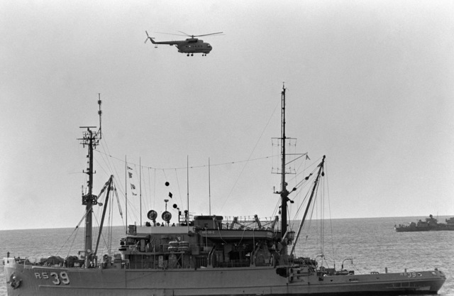 PH1 Felimon Barbante Sea of Japan....A Soviet Mi-14 Haze helicopter flies past the salvage ship USS Conserver (ARS-39) during salvage operations for downed Korean Air Lines Flight 007 (KAL-007). The commercial jet was shot down by Soviet aircraft over Sakhalin Island on Aug. 30, 1983. All 269 passengers and crewmen were killed. OFFICIAL U.S. NAVY PHOTO (RELEASED)
