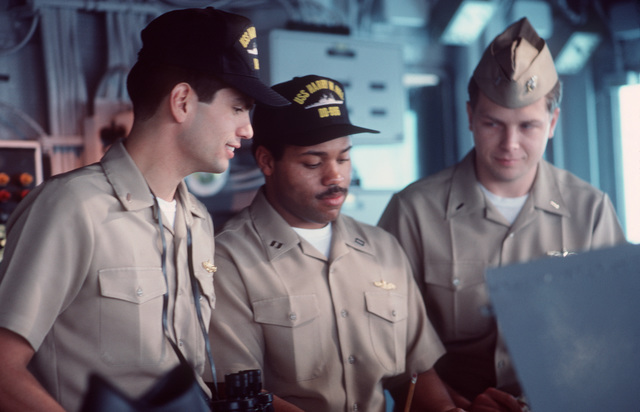 PH1 Paul Pappas ....LT. j.g. Daniel C. Espinoza, a visiting Hispanic officer, confers with LT. Eric V. Clayton and LT. j.g. Todd J. Wilmot on the bridge of the destroyer USS Harry W. Hill (DD-986). OFFICIAL U.S. NAVY PHOTO (RELEASED)