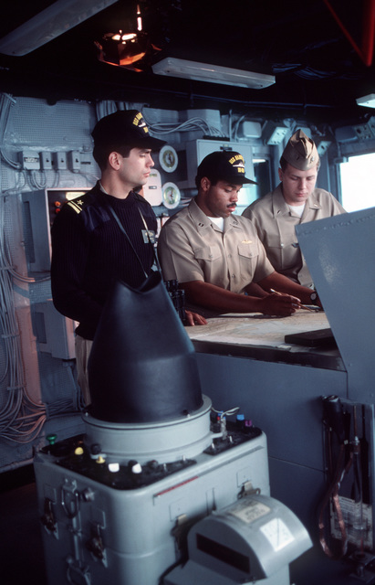 PH1 Paul Pappas ....LT. j.g. Daniel C. Espinoza, a visiting Hispanic officer, LT. Eric V. Clayton and LT. j.g. Todd J. Wilmot consult a navigational chart on the bridge of the destroyer USS Harry W. Hill (DD-986). OFFICIAL U.S. NAVY PHOTO (RELEASED)