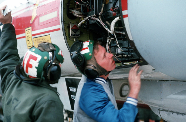 PH1 Paul Pappas Naval Air Station, Miramar....An ordnanceman attaches an AIM-54A Phoenix missile to an F-14A Tomcat aircraft during ordnance loading operations. OFFICIAL U.S. NAVY PHOTO (RELEASED)