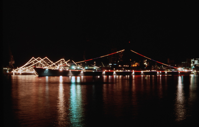 PH2 Barry Orell Sydney, Australia....A view of the battleship USS New Jersey (BB-62) lit up at night during the Australian bicentennial celebration. OFFICIAL U.S. NAVY PHOTO (RELEASED)