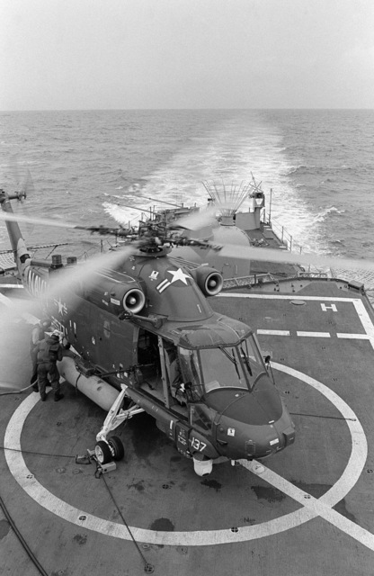 PH2 M.A. Harnar Persian Gulf....A Light Helicopter Anti-submarine Squadron (HSL-32) SH-2F Seasprite helicopter is refueled before takeoff from the destroyer USS Wainwright (CG-28) during escort operations. OFFICIAL U.S. NAVY PHOTO (RELEASED)