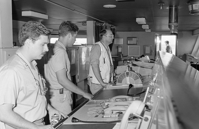 PH2 M.A. Harnar Persian Gulf....Rear Adm. (lower half) D. A. Dyer, commander, Destroyer Squadron 22, right, stands on the bridge of the tanker Gas Queen with another officer, center, and LT. Ash, squadron operations officer. OFFICIAL U.S. NAVY PHOTO (RELEASED)
