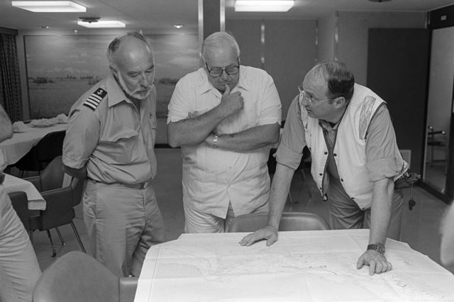PH2 M.A. Harnar Persian Gulf....Rear Adm. (lower half) D. A. Dyer, commander, Destroyer Squadron 22, discusses escort operations with the captain of the Gas Queen and another officer on the bridge of the tanker. OFFICIAL U.S. NAVY PHOTO (RELEASED)