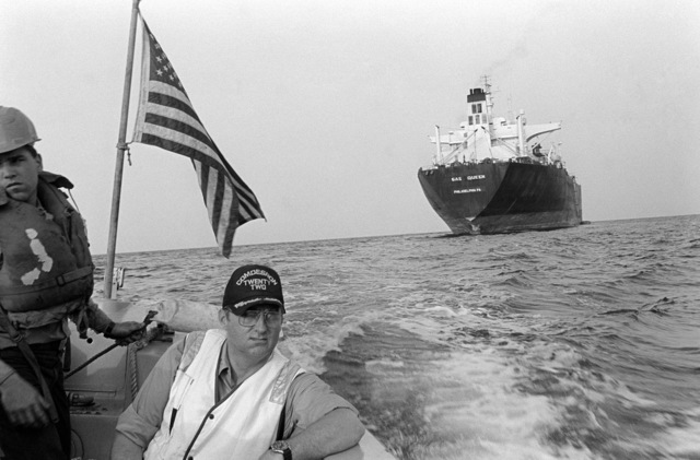 PH2 M.A. Harnar Persian Gulf....Rear Adm. (lower half) D. A. Dyer, commander, Destroyer Squadron 22, rides a whale boat headed away from the tanker Gas Queen after coordinating escort procedures for the ship. OFFICIAL U.S. NAVY PHOTO (RELEASED)
