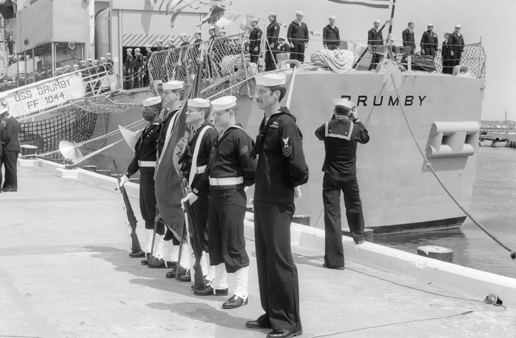 PHAA Richard D. Byrd Naval Station, Charleston, S.C....A U.S. Navy color guard stands on the pier as the crew of the frigate USS Brumby (FF-1044) mans the rails prior to ceremonies marking the decommissioning of the Brumby and the guided missile frigate USS Richard L. Page (FFG-5) and their transfer to the Pakistani navy. The ships are being recommissioned as the PNS Harbah (F-266) and PNS Tabuk (D-159), respectively. OFFICIAL U.S. NAVY PHOTO (RELEASED)
