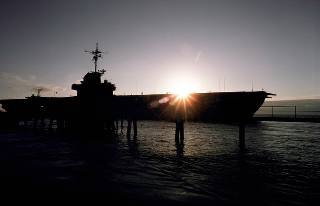 PHC Jeff Hilton Florida....A silhouette of the training carrier USS Lexington (AVT-16) departing Pensacola. The Lexington is the oldest U.S. naval carrier still in operation. OFFICIAL U.S. NAVY PHOTO (RELEASED)