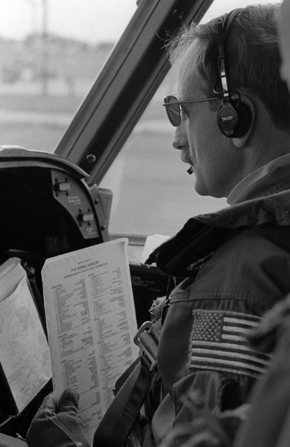 PHCS Ron Bayles ....A Patrol Squadron 47 (VP-47) P-3C Orion aircraft co-pilot performs a preflight systems check before takeoff. OFFICIAL U.S. NAVY PHOTO (RELEASED)