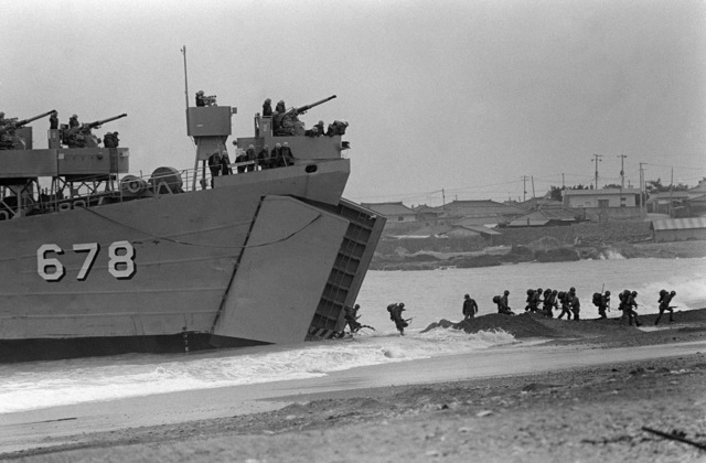 PHCS Ron Bayles South Korea....Personnel offload from the tank landing ship Buk Han (LST-678) during exercise Team Spirit '86. OFFICIAL U.S. NAVY PHOTO (RELEASED)