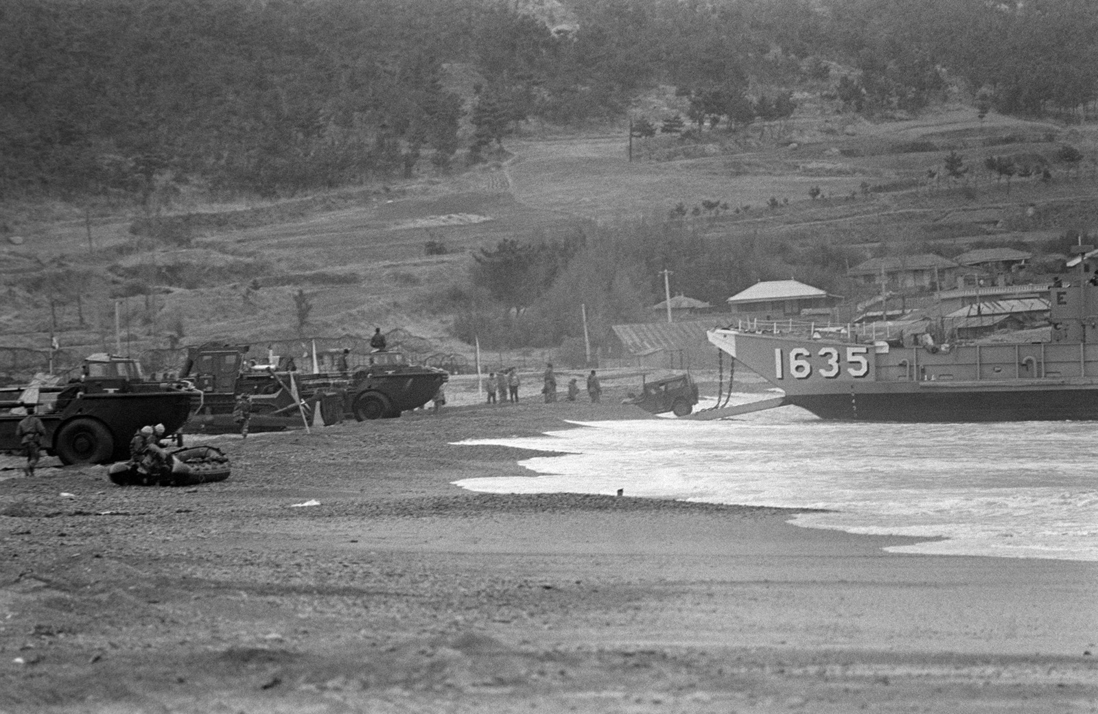 PHCS Ron Bayles South Korea....Vehicles come ashore from utility landing craft 1635 (LCU-1635) during exercise Team Spirit '86. OFFICIAL U.S. NAVY PHOTO (RELEASED)