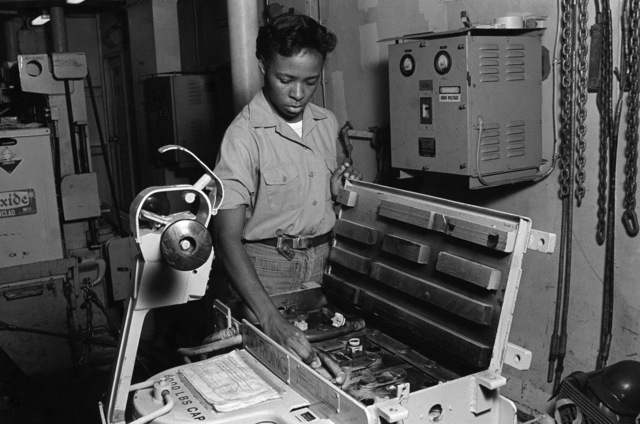 PHCS Ron Bayles Subic Bay, Philippines....A crewman checks the batteries in an electric pallet jack aboard the destroyer tender USS Cape Cod (AD-43). OFFICIAL U.S. NAVY PHOTO (RELEASED)