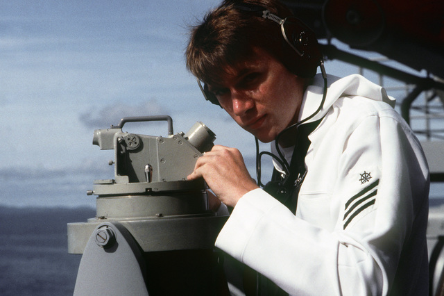 PHCS Ron Bayles Subic Bay, Philippines....A quartermaster seaman uses a telescopic alidade to take a bearing aboard the battleship USS New Jersey (BB-62). OFFICIAL U.S. NAVY PHOTO (RELEASED)