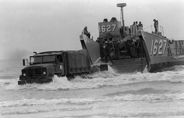 PHCS Ron Bayles Thailand....An M-934 cargo/personnel truck offloads from the utility landing craft 1627 (LCU-1627) during exercise Cobra Gold '86. OFFICIAL U.S. NAVY PHOTO (RELEASED)