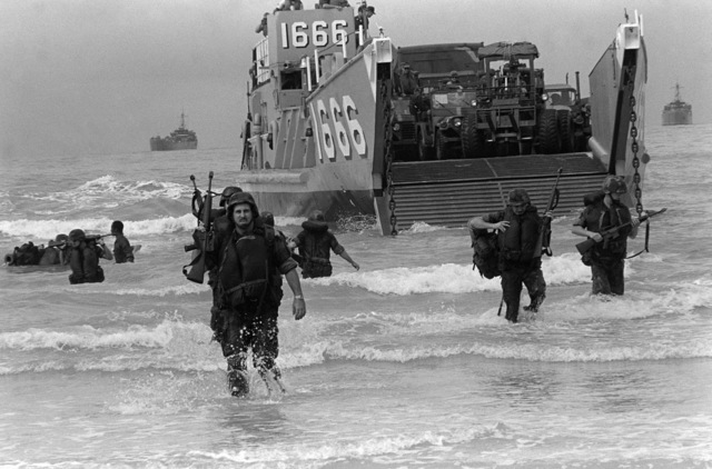 PHCS Ron Bayles Thailand....Marines come ashore from the utility landing craft 1666 (LCU-1666) during exercise Cobra Gold '86. OFFICIAL U.S. NAVY PHOTO (RELEASED)