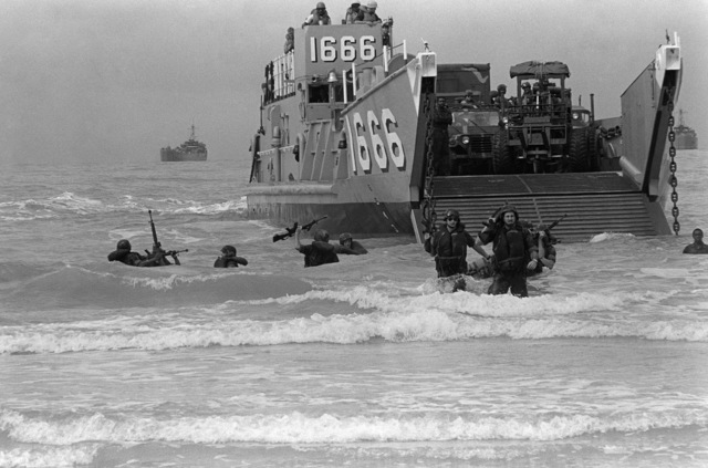 PHCS Ron Bayles Thailand....Marines come ashore from utility landing craft 1666 (LCU-1666) during exercise Cobra Gold '86. OFFICIAL U.S. NAVY PHOTO (RELEASED)
