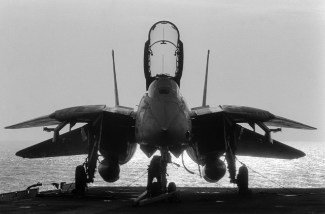 PHCS Ronald W. Bayles South China Sea....A front view of an F-14A Tomcat aircraft parked on the flight deck of the aircraft carrier USS Kitty Hawk (CV-63). OFFICIAL U.S. NAVY PHOTO (RELEASED)