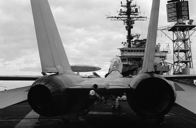 PHCS Ronald W. Bayles South China Sea....A rear view of the tail section and engine exhausts of an F-14A Tomcat aircraft parked on the flight deck of the aircraft carrier USS Kitty Hawk (CV-63). OFFICIAL U.S. NAVY PHOTO (RELEASED)