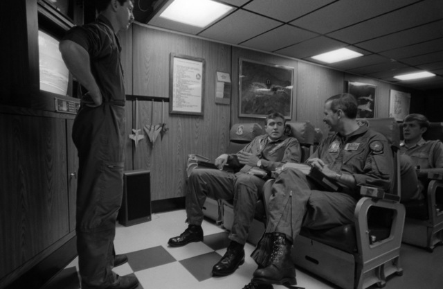 PHCS Ronald W. Bayles South China Sea....Vice Adm. Paul D. Miller, commander, 7th Fleet, and other pilots attend a preflight meeting in the briefing room aboard the aircraft carrier USS Kitty Hawk (CV-63). OFFICIAL U.S. NAVY PHOTO (RELEASED)