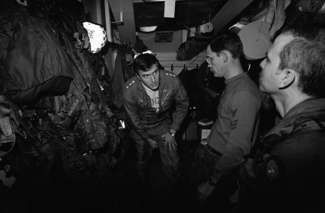 PHCS Ronald W. Bayles South China Sea....Vice Adm. Paul D. Miller, commander, 7th Fleet, puts on a flight suit prior to his flight in an F-14A Tomcat aircraft aboard the aircraft carrier USS Kitty Hawk (CV-63). OFFICIAL U.S. NAVY PHOTO (RELEASED)