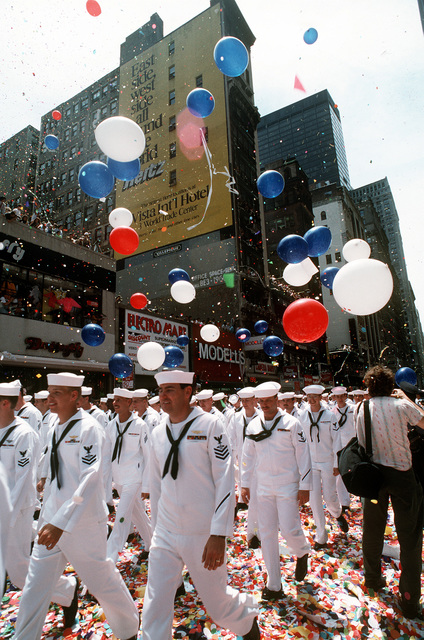 Sailors pick their way through the confetti-covered streets as they march in the city's victory parade for the returning veterans of Operation Desert Shield and Operation Desert Storm