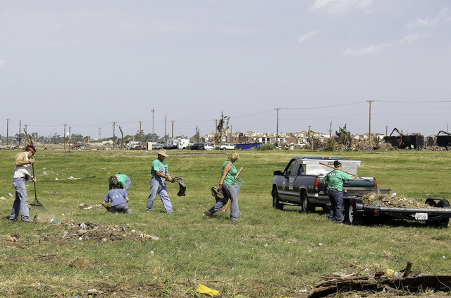 Severe Storm ^ Tornado - Joplin, Mo. , June 25, 2011  -  Volunteers collect debris along Duquesne Street, after an EF-5 tornado struck the cities of Joplin and Duquesne on May 22. - Photo by: Rossyveth Rey-Berríos/FEMA