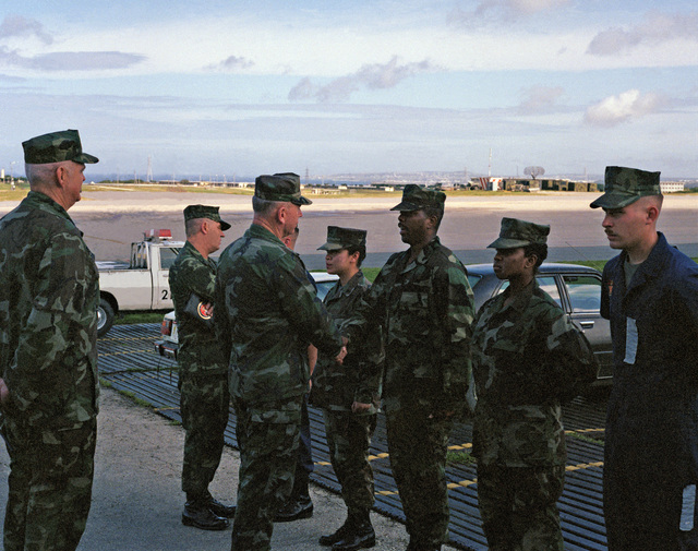 SGT. E. Alicea Okinawa, Japan....GEN. Paul X. Kelley, commandant of the Marine Corps, speaks with a member of the crash crew platoon at Marine Corps Air Station, Futenma. SGT. MAJ. Robert E. Cleary, sergeant major of the Marine Corps, is on the left. OFFI
