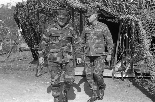 SGT. J. H. Milton Uncheon Base Camp, South Korea....LT. COL. A.V. Garsys, right, commanding officer, 3rd Brigade Service Support Group (BSSG-3), conducts MAJ. GEN. Edwin J. Godfrey, left, commanding general, III Marine Amphibious Force/3rd Marine Division