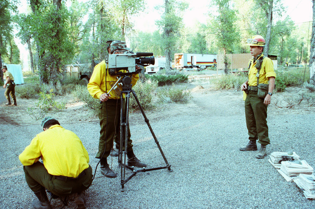 SPEC. Brian Cumper Wyoming....Army audiovisual cameramen film a member of a firefighting team during an interview regarding firefighting efforts in Yellowstone National Park. OFFICIAL U.S. ARMY PHOTO (RELEASED)