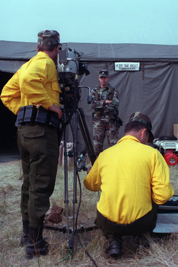 SPEC. Brian Cumper Wyoming....Army audiovisual cameramen film LT. COL. Brittan, commander, 4th Battalion, 23rd Infantry Regiment, during an interview regarding his troops' firefighting efforts in Yellowstone National Park. OFFICIAL U.S. ARMY PHOTO (RELEAS