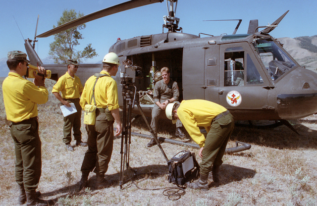SPEC. Brian Cumper Wyoming....Members of a Combat Pictorial Detachment interview SGT. Timothy C. Moore, 54th Medical Detachment, regarding his duties during firefighting efforts at Yellowstone National Park. OFFICIAL U.S. ARMY PHOTO (RELEASED)