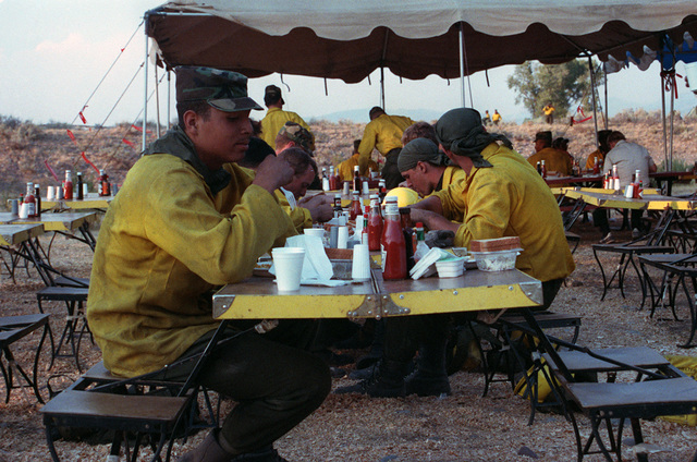 SPEC. Brian Cumper Wyoming....Members of a joint military/civilian firefighting team take a lunch break from firefighting efforts in Yellowstone National Park. OFFICIAL U.S. ARMY PHOTO (RELEASED)