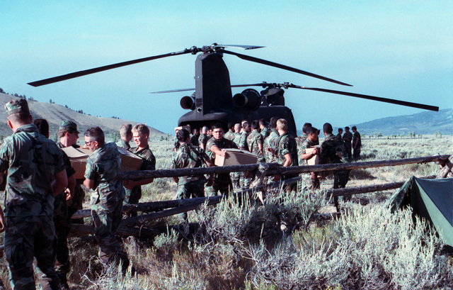 SPEC. Brian Cumper Wyoming....Members of a U.S. Army firefighting team unload supplies from a CH-47 Chinook helicopter during firefighting efforts in Yellowstone National Park. OFFICIAL U.S. ARMY PHOTO (RELEASED)