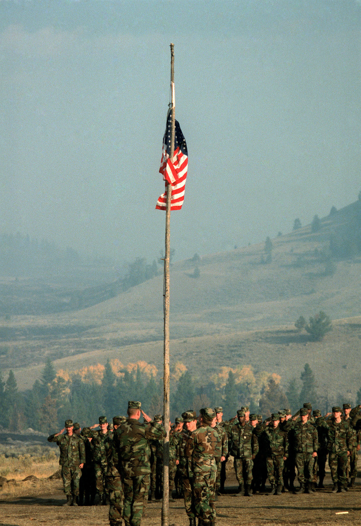 SPEC. Brian Cumper Wyoming....Members of the 4th Battalion, 23rd Infantry Regiment, lower the flag at Clover Mist Camp, their base during firefighting efforts in Yellowstone National Park. OFFICIAL U.S. ARMY PHOTO (RELEASED)