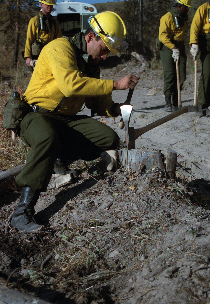 SPEC. Brian Cumper Wyoming....Members of the 4th Battalion, 23rd Infantry Regiment, sharpen axes in preparation for building fire lines during firefighting efforts in Yellowstone National Park. OFFICIAL U.S. ARMY PHOTO (RELEASED)