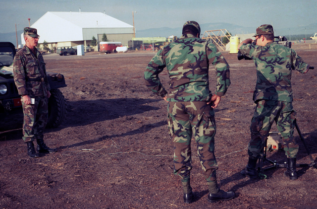 SPEC. Brian Cumper Yellowstone Airport, Wyo....SGT. John Bates and SPEC. Gatsch film an interview with Brig. GEN. James B. Taylor, deputy commander, 9th Infantry, Fort Lewis, Wash. Taylor is discussing his troops firefighting efforts in Yellowstone Nation