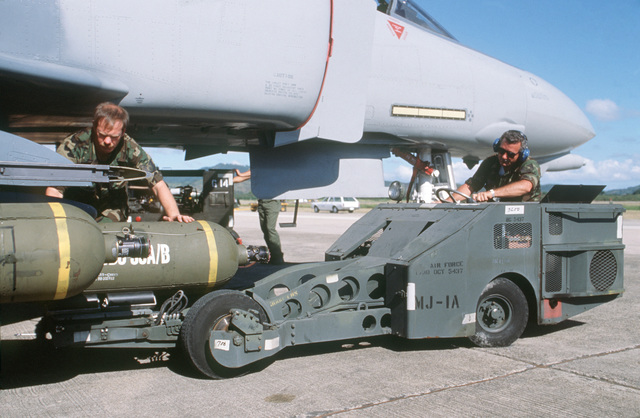 STAFF SGT. David McLeod Naval Air Station, Roosevelt, Roads, Puerto Rico.... Air Force Reserve munitions personnel use an MJ-1A bomb loader to arm a 42nd Tactical Fighter Squadron F-4D Phantom II aircraft during exercise Patriot Pearl. OFFICIAL U.S. AIR F