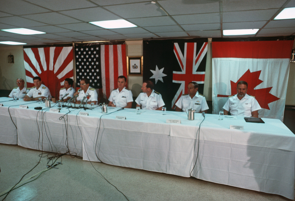 Terry Cosgrove Pacific Ocean....Attending a RIMPAC '88 press conference aboard the aircraft carrier USS Nimitz (CVN-68) are, (l-r): Rear Adm. J. F. Shaw, commander, Cruiser Destroyer Group One; Rear Adm. (lower half) T.A. Mercer, commander, Carrier Group Seven; Rear Adm. Toshio Muranaka, Japan Maritime Self Defense Force; Vice Adm. D. Hernandez, commander, 3rd Fleet; Rear Adm. P. Sinclair, maritime commander Australia; Rear Adm. R. George, Canadian Maritime Force, Pacific; CAPT. P. Farthing, commanding officer, HMAS Hobart (DDG-39); and CAPT. G. Garnett, Canadian commander, Destroyer Squadron Two. OFFICIAL U.S. NAVY PHOTO (RELEASED)