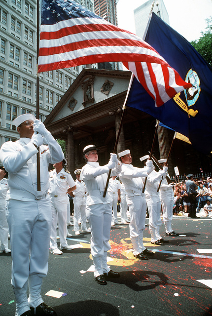 The members of a Navy color guard stand at attention as they wait to resume marching in the city's victory parade for the returning veterans of Operation Desert Shield and Operation Desert Storm