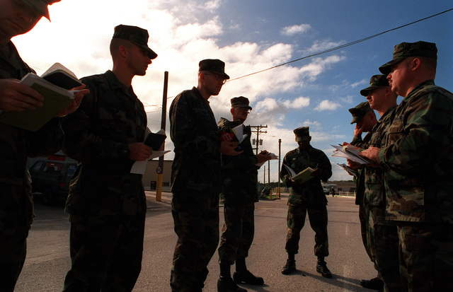 The officer in charge of Naval Mobile Construction Battalion One-Three-Three (NMCB-133) briefs his men at morning quarters on their upcoming deployment to Bosnia to take part in the peace keeping mission. NMCB-133 is to construct tent cities for American forces in Bosnia