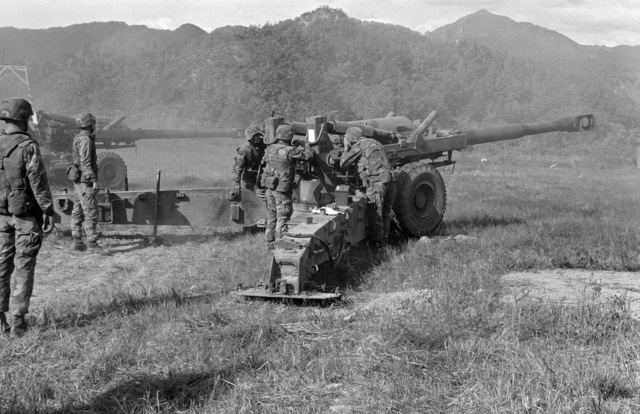 Uncheon Base Camp, South Korea....Marine artillerymen prepare to fire an M-198 155mm howitzer during exercise Bear Hunt '87. OFFICIAL U.S. MARINE CORPS PHOTO (RELEASED)