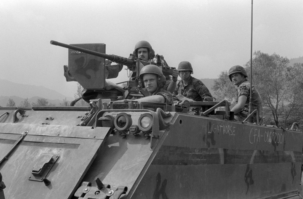 Uncheon Base Camp, South Korea....Soldiers of the Army's 2nd Infantry Division deployed in an M-113 armored personnel carrier during exercise Bear Hunt '87. An M-2 .50 caliber machine gun is mounted on the vehicle. OFFICIAL U.S. MARINE CORPS PHOTO (RELEAS