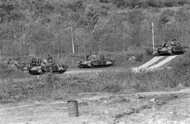 Uncheon Base Camp, South Korea....South Korean army M-48A5 main battle tanks pause along a road during exercise Bear Hunt '87. OFFICIAL U.S. MARINE CORPS PHOTO (RELEASED)