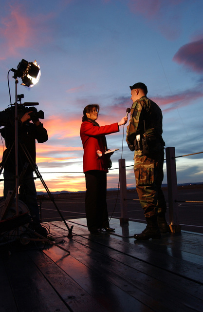 U.S. Air Force MASTER SGT. Dale Gunter (right), of the 120th Security Forces Squadron, Montana Air National Guard, is interviewed by Cindy Cieluch for KRTV News about his unit's role in providing security for U.S. President George W. Bush arrival at Great Falls International Airport Air Guard Station, Mont., on Feb. 3, 2005. Great Falls was one of five cities visited by the President for Town Hall meetings on social security issues following his State of the Union Address. (U.S. Air Force PHOTO by TECH. SGT. Roger M. Dey) (Released)