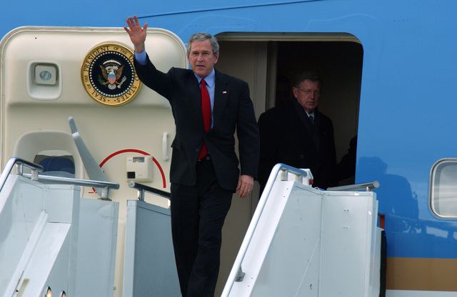 U.S. President George W. Bush waves to the crowd as he exits Air Force One upon his arrival at the 120th Fighter Wing, Great Falls International Airport Air Guard Station, Mont., on Feb. 3, 2005. Great Falls was one of five cities visited by the President for Town Hall meetings on social security issues following his State of the Union Address. (U.S. Air Force PHOTO by TECH. SGT. Roger M. Dey) (Released)