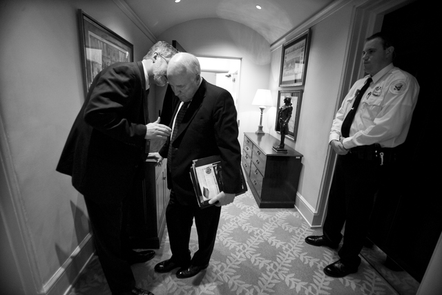 David Addington Talks with Vice President Cheney in the West Wing Hallway